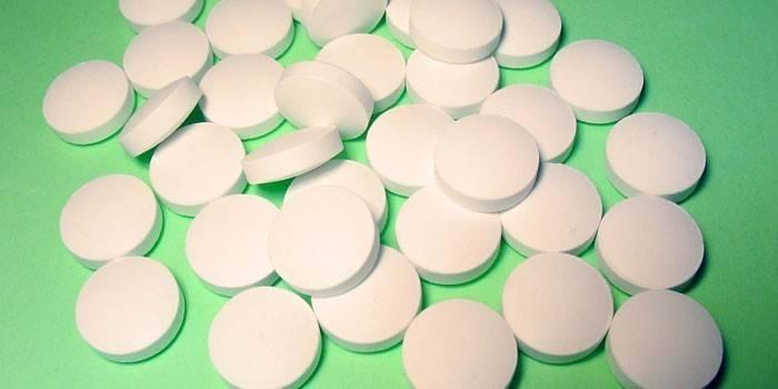 Россыпь белых таблеток
